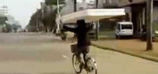 Man delivers mattress on bicycle!